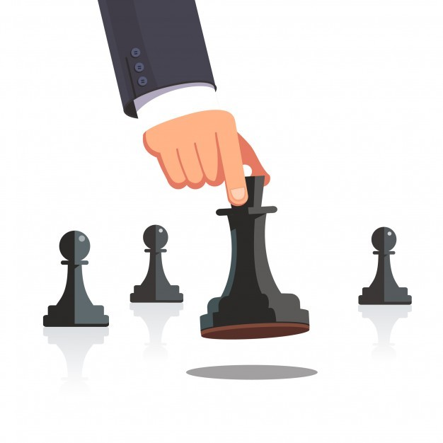 Business man hand making a strategic chess move
