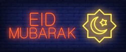 Eid mubarak neon sign. glowing bar lettering and muslim symbol